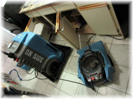 Industrial strength heating fans occupy kitchen area.